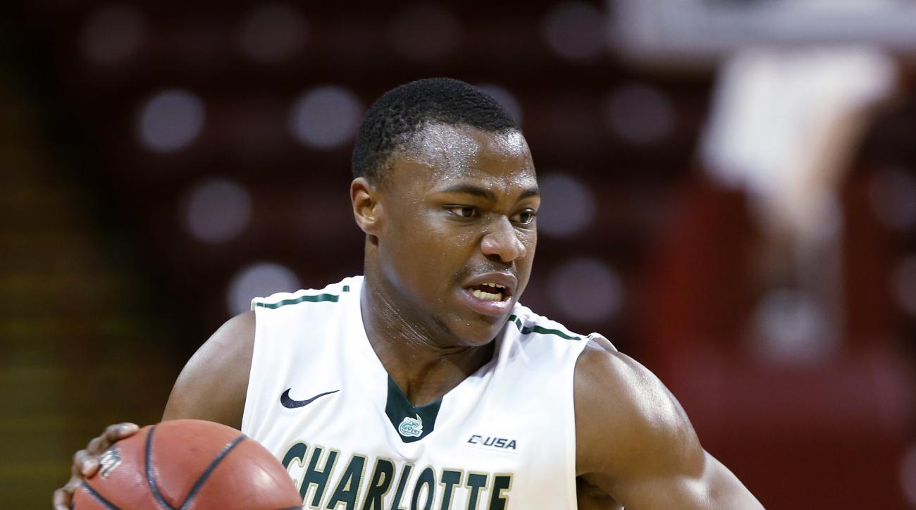 FILE - In this Nov. 23, 2014, file photo, Charlotte's Torin Dorn pushes the ball up court against Miami during the first half of the championship game at the Charleston Classic NCAA college basketball tournament in Charleston, S.C. Dorn, the Conference US