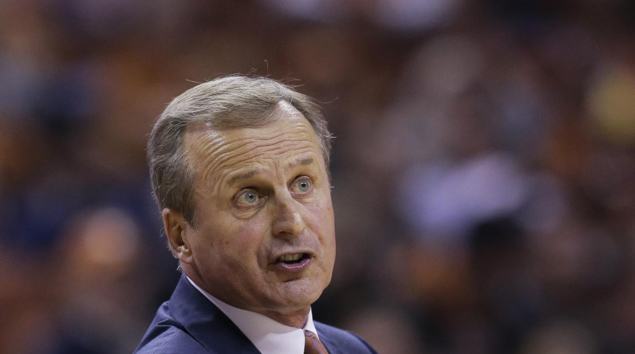 Texas coach Rick Barnes talks to his players during the second half of an NCAA college basketball game against Baylor, Monday, March 2, 2015, in Austin, Texas. Texas won 61-59 in overtime. (AP Photo/Eric Gay)
