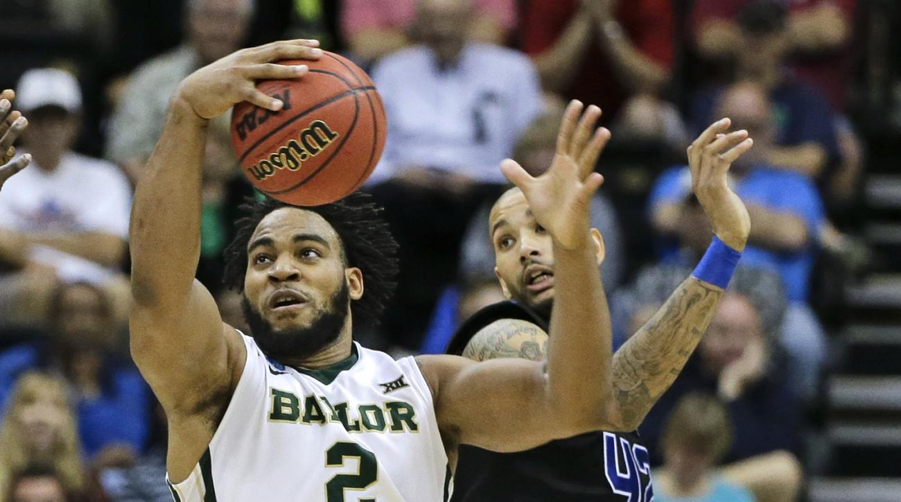 Baylor forward Rico Gathers (2) grabs a rebound away from Georgia State's Curtis Washington, right, during the second half in the second round of the NCAA college basketball tournament, Thursday, March 19, 2015, in Jacksonville, Fla. (AP Photo/Chris O'Mea