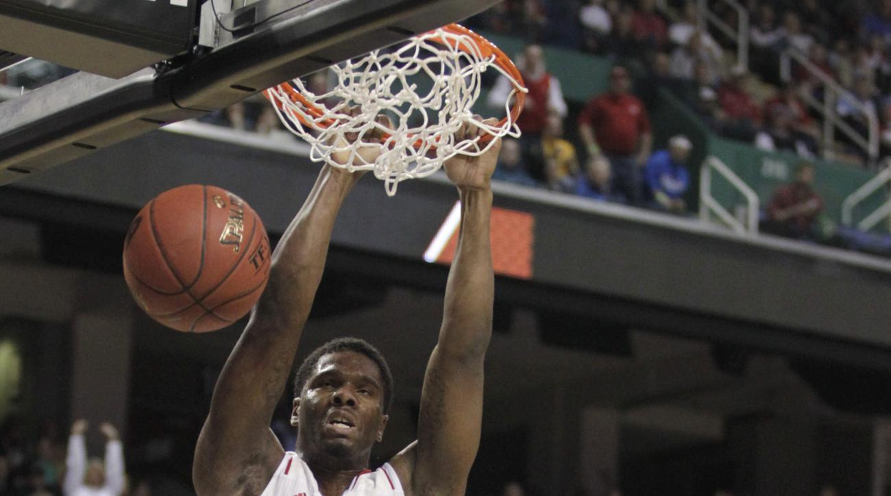North Carolina State's Lennard Freeman (10) dunks as Miami's Garrius Adams (25) watches during the first half of a second round NCAA college basketball game at the Atlantic Coast Conference tournament in Greensboro, N.C., Thursday, March 13, 2014. (AP Pho