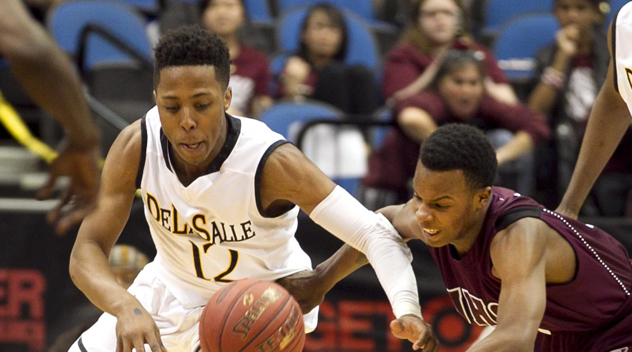 DeLaSalle guard Jarvis Johnson (12) and St. Paul Johnson Malik Jones, right,  battle for the ball in the Class 3A boys' high school basketball championship, Saturday March 14, 2015, in Minneapolis.(AP Photo/Andy King)