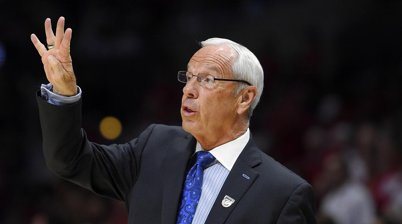 North Carolina head coach Roy Williams signals during the first half of a college basketball regional semifinal against Wisconsin in the NCAA Tournament, Thursday, March 26, 2015, in Los Angeles. (AP Photo/Mark J. Terrill)