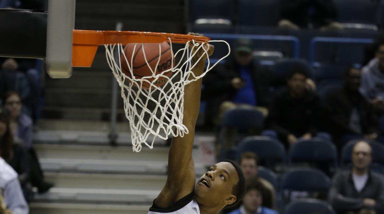 FILE - In this March 19, 2014, file photo, Wofford guard Jeremiah Tate dunks during a practice at the NCAA college basketball tournament in Milwaukee. Wofford says Tate died early Monday, June 22, 2015, in Lake Wylie, S.C., about 18 miles southeast of Cha
