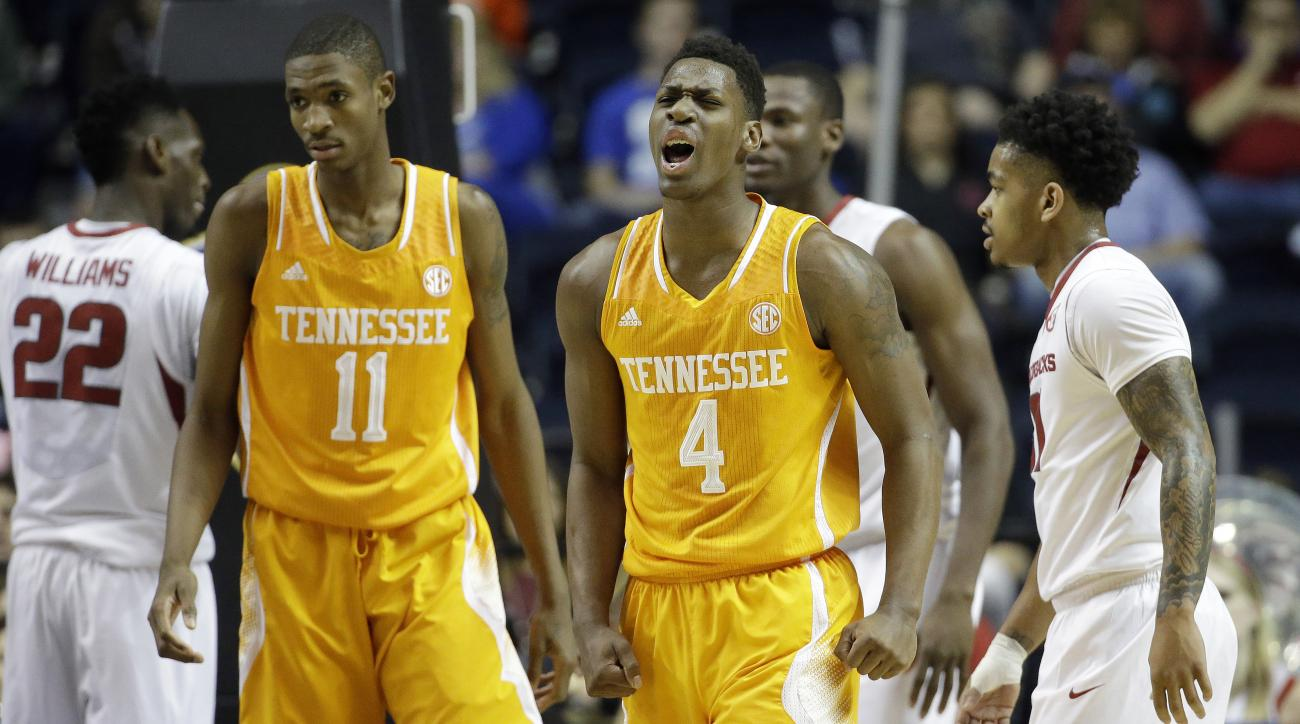 FILE - In this March 13, 2015, Tennessee forward Armani Moore (4) reacts against Arkansas during the first half of an NCAA college basketball game in the quarterfinal round of the Southeastern Conference tournament in Nashville, Tenn. Moore's college care