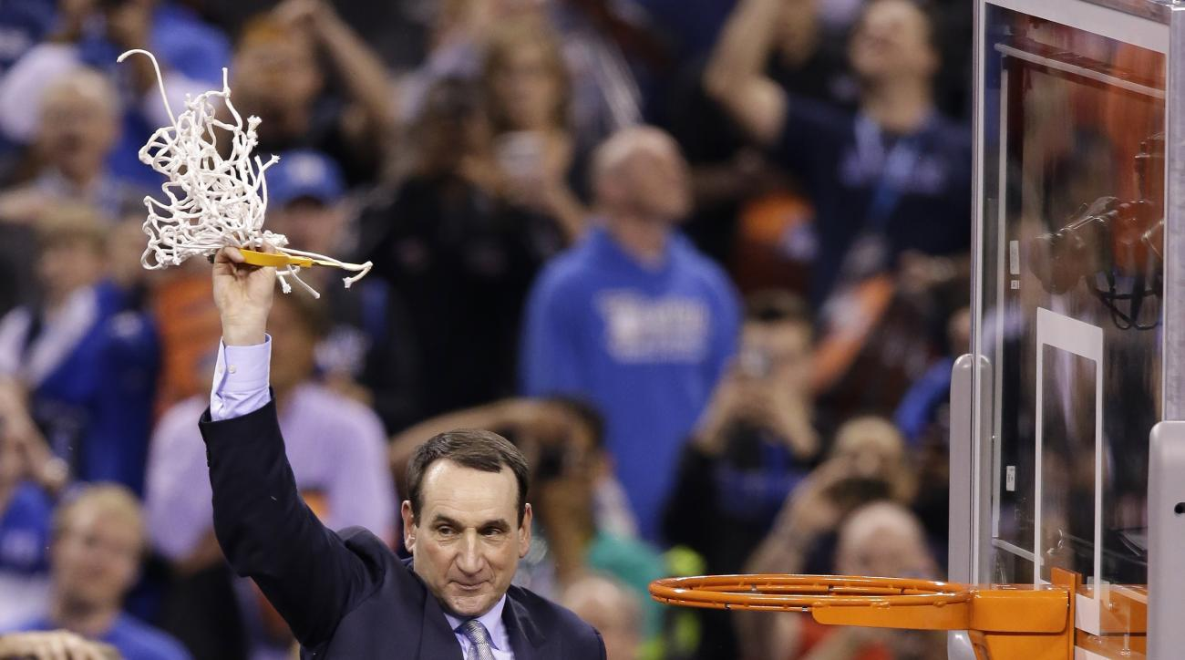 Duke head coach Mike Krzyzewski cuts down the net after his team's 68-63 victory over Wisconsin in the NCAA Final Four college basketball tournament championship game Monday, April 6, 2015, in Indianapolis. (AP Photo/Darron Cummings)