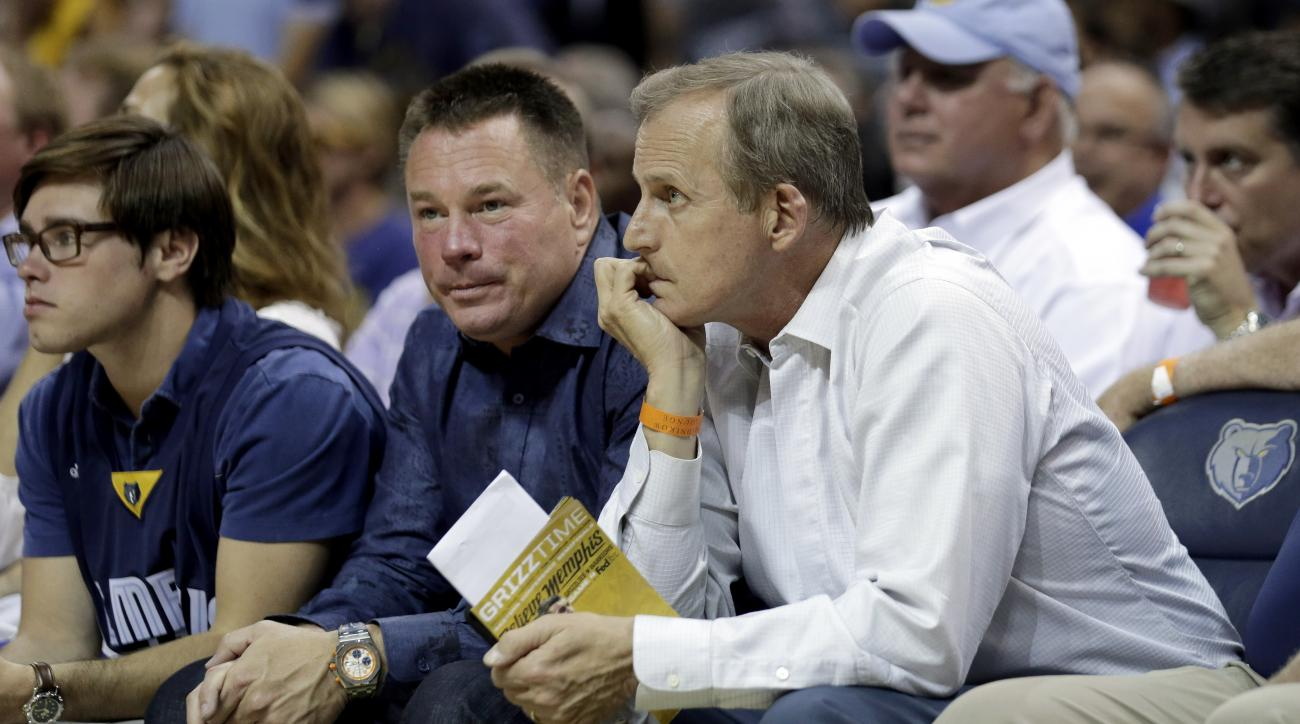 FILE - In this May, 2015 file photo, Tennessee head football coach Butch Jones, center, and head basketball coach Rick Barnes, right, watch the first half of Game 4 of a second-round NBA basketball Western Conference playoff series between the Memphis Gri