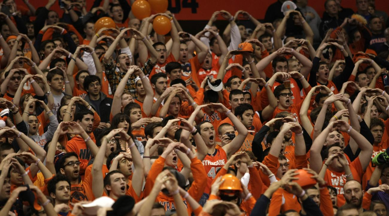 The Syracuse University student section in the Carrier Dome during the singing of the National Anthem before an NCAA college basketball game against Pittsburgh in Syracuse, N.Y., Saturday, Jan. 18, 2014. Syracuse won 59-54. (AP Photo/Nick Lisi)