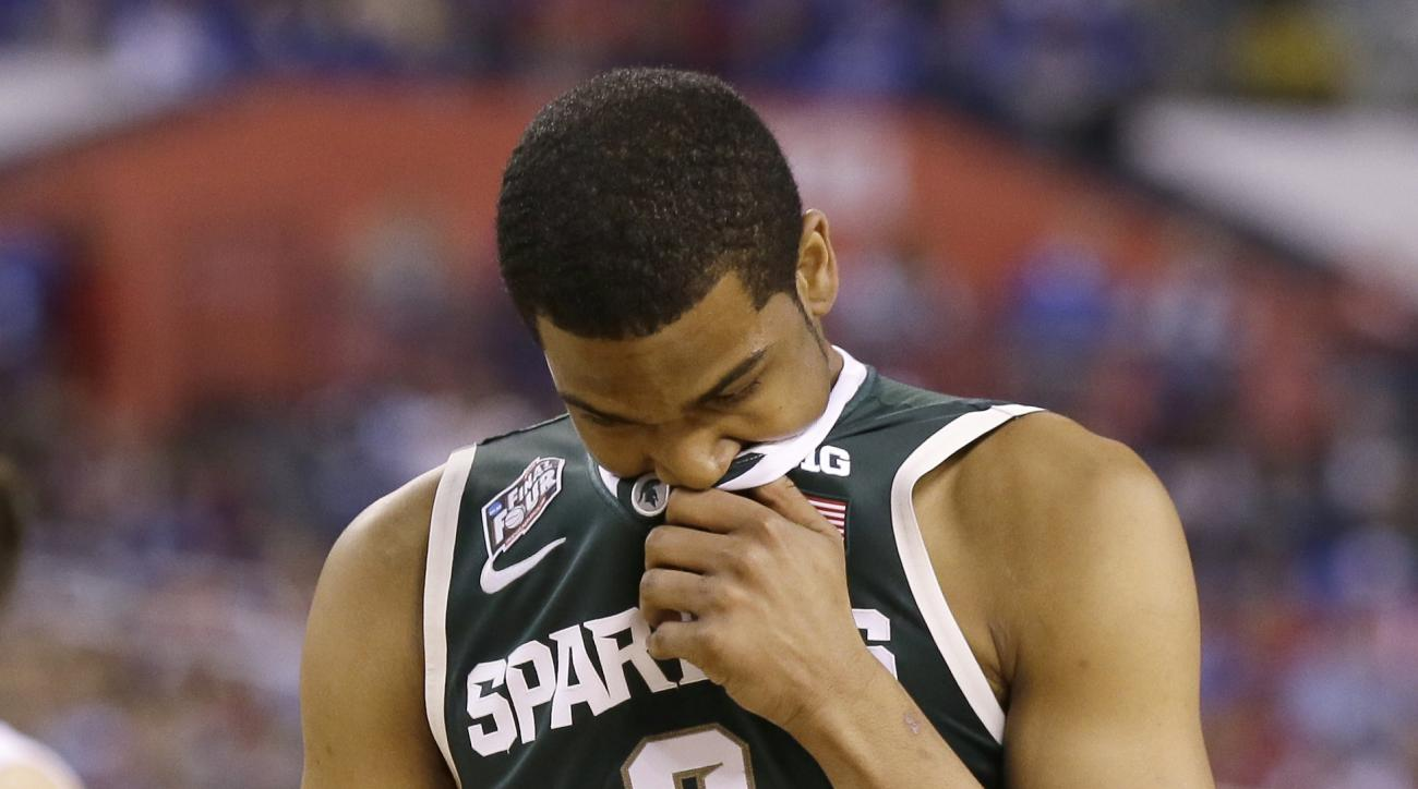 Michigan State's Alvin Ellis III reacts during the second half of the NCAA Final Four tournament college basketball semifinal game against Duke Saturday, April 4, 2015, in Indianapolis. Duke won 81-61. (AP Photo/Charlie Neibergall)
