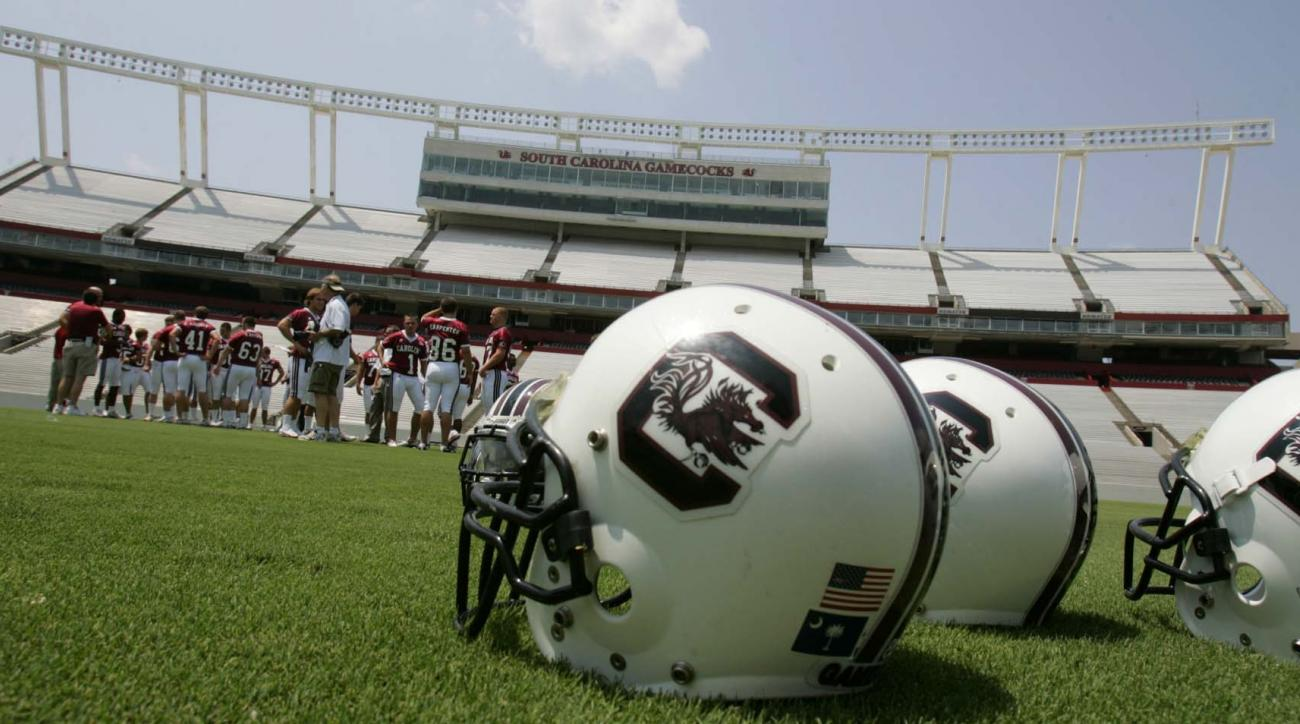 Helmets are placed on the field during Media Day for the South Carolina football team Friday, Aug. 4, 2006, at Williams-Brice Stadium in Columbia, S.C. Steve Spurrier is preparing to start his second fall with the Gamecocks, building on their midseason ru