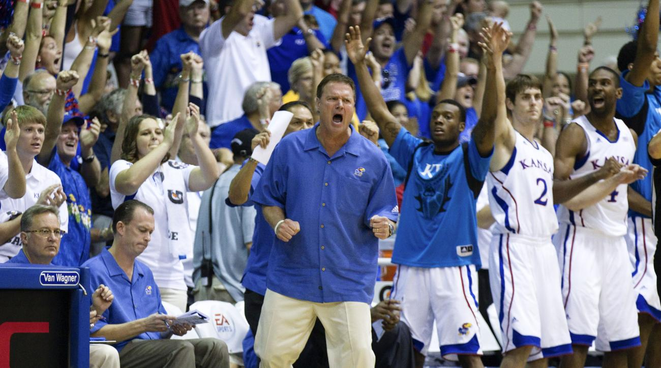 Kansas head coach Bill Self is pumped up along with his team in the second half of an NCAA college basketball game Wednesday, Nov. 23, 2011, in Lahaina, Hawaii. Duke defeated Kansas 68-61 to win the 2011 Maui Invitationl. (AP Photo/Eugene Tanner)