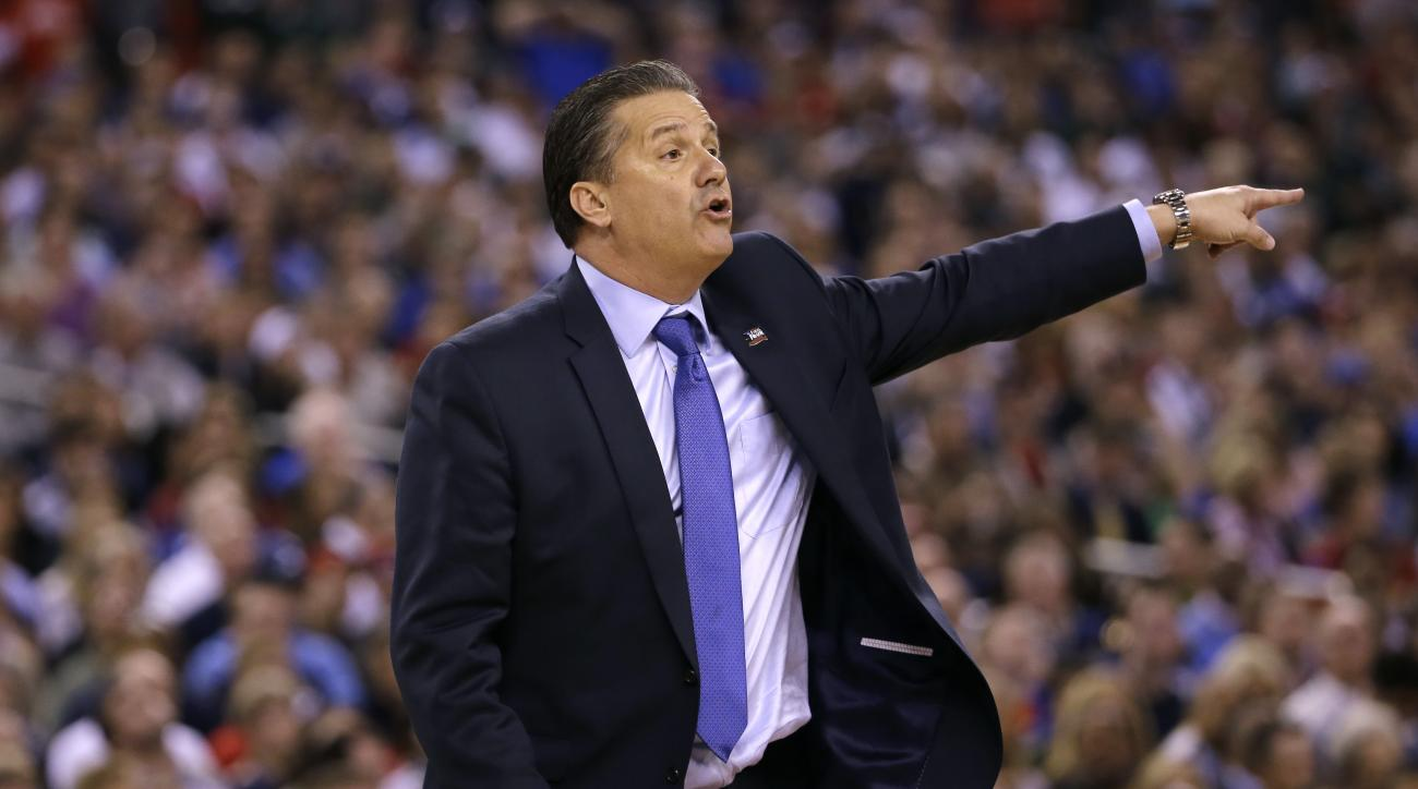 Kentucky head coach John Calipari directs his team during the first half of the NCAA Final Four tournament college basketball semifinal game against Wisconsin Saturday, April 4, 2015, in Indianapolis. (AP Photo/David J. Phillip)