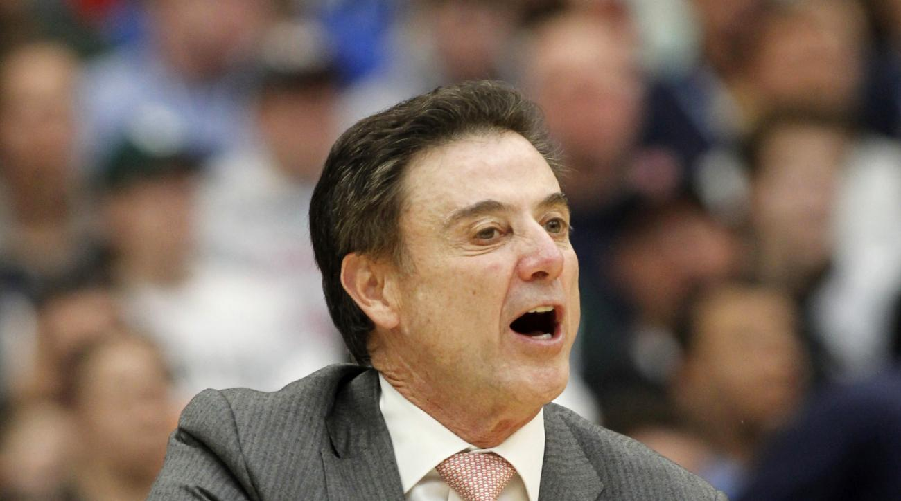 Louisville head coach Rick Pitino during the second half of a regional final against Michigan State in the NCAA men's college basketball tournament Sunday, March 29, 2015, in Syracuse, N.Y.  (AP Photo/Nick Lisi)