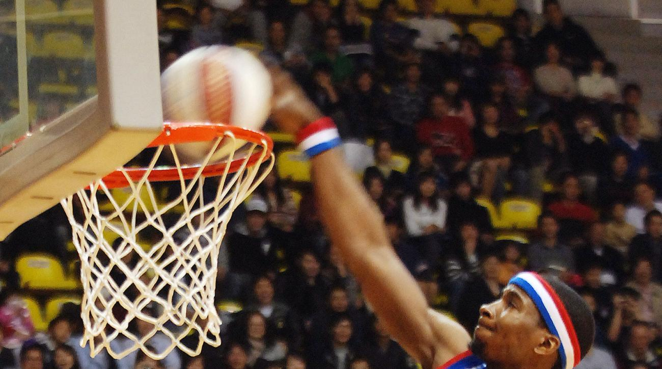 FILE - In this Wednesday, Dec. 2, 2009 file photo, Bam Bam Bamiro of the Harlem Globetrotters dunks during their show in Taipei, Taiwan. Say it ain't so. The Harlem Globetrotters will no longer be beating up on the Washington Generals game after game afte