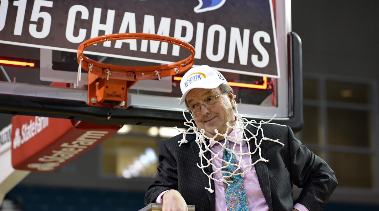 FILE - In this March 8, 2015, file photo, Coastal Carolina coach Cliff Ellis poses after cutting the net at the end of the Big South Conference Championship NCAA college basketball game against Winthrop, in Conway, S.C. Cliff Ellis is accustomed to making