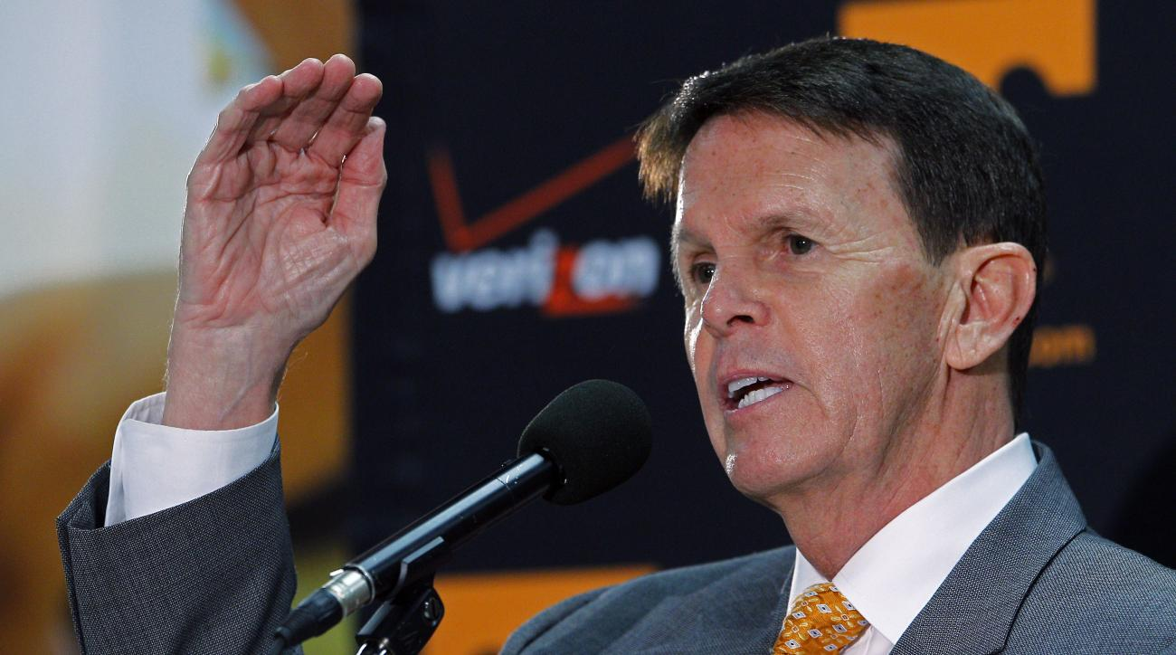 FILE - In this March 27, 2015, file photo, University of Tennessee athletic director Dave Hart gestures as he speaks to reporters about the firing of head basketball coach Donnie Tyndall, in Knoxville, Tenn. Hart is ready to look ahead to 2015-16 after a