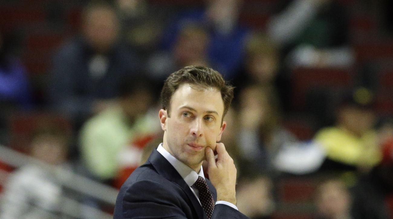 Minnesota head coach Richard Pitino directs his team in the second half of an NCAA college basketball game against Ohio State in the second round of the Big Ten Conference tournament, Thursday, March 12, 2015, in Chicago. (AP Photo/Nam Y. Huh)