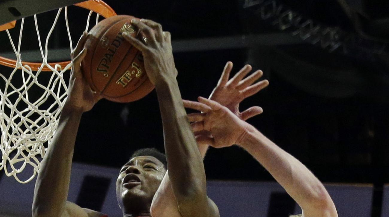 Indiana's Emmitt Holt (25) and Maryland's Evan Smotrycz (1) become entangled as they go for a rebound in the first half of an NCAA college basketball game in the quarterfinals of the Big Ten Conference tournament in Chicago, Friday, March 13, 2015. (AP Ph