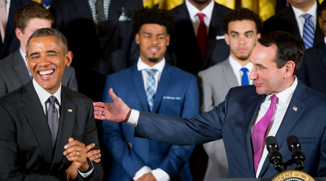 Duke head coach Mike Krzyzewski, right, accompanied by President Barack Obama, left, speaks in the East Room of the White House in Washington, Tuesday, Sept. 8, 2015, during a ceremony honoring the NCAA Champion Duke Blue Devils men's basketball team. (AP
