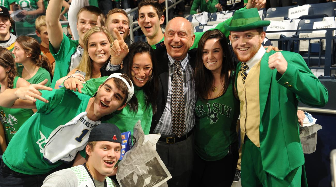 ESPN analyst Dick Vitale poses with Notre Dame and the leprechaun in an NCAA college basketball game with Duke Wednesday Jan. 28, 2015 in South Bend, Ind. (AP Photo/Joe Raymond)