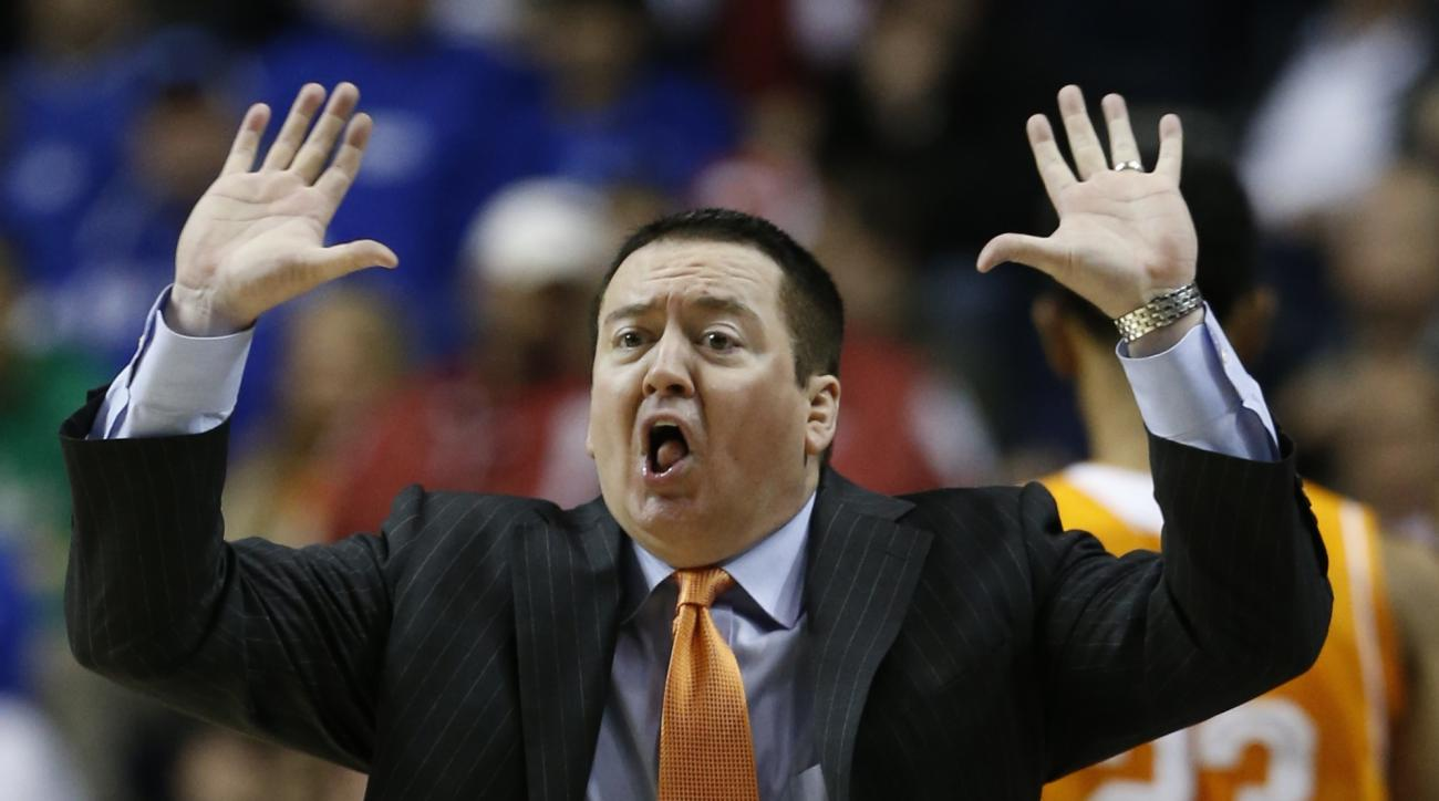 Tennessee head coach Donnie Tyndall calls a play against Arkansas during the second half of an NCAA college basketball game in the quarterfinal round of the Southeastern Conference tournament, Friday, March 13, 2015, in Nashville, Tenn. (AP Photo/Steve He