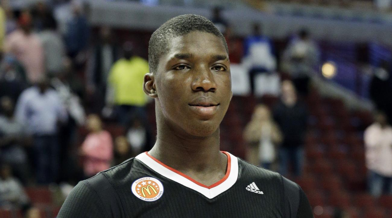 East orward Cheick Diallo of Our Savior New American in Centereach, NY., holds the MVP trophy after East defeated West 111-91 in the McDonald's All-American boys basketball game in Chicago on Wednesday, April 1, 2015. (AP Photo/Nam Y. Huh)