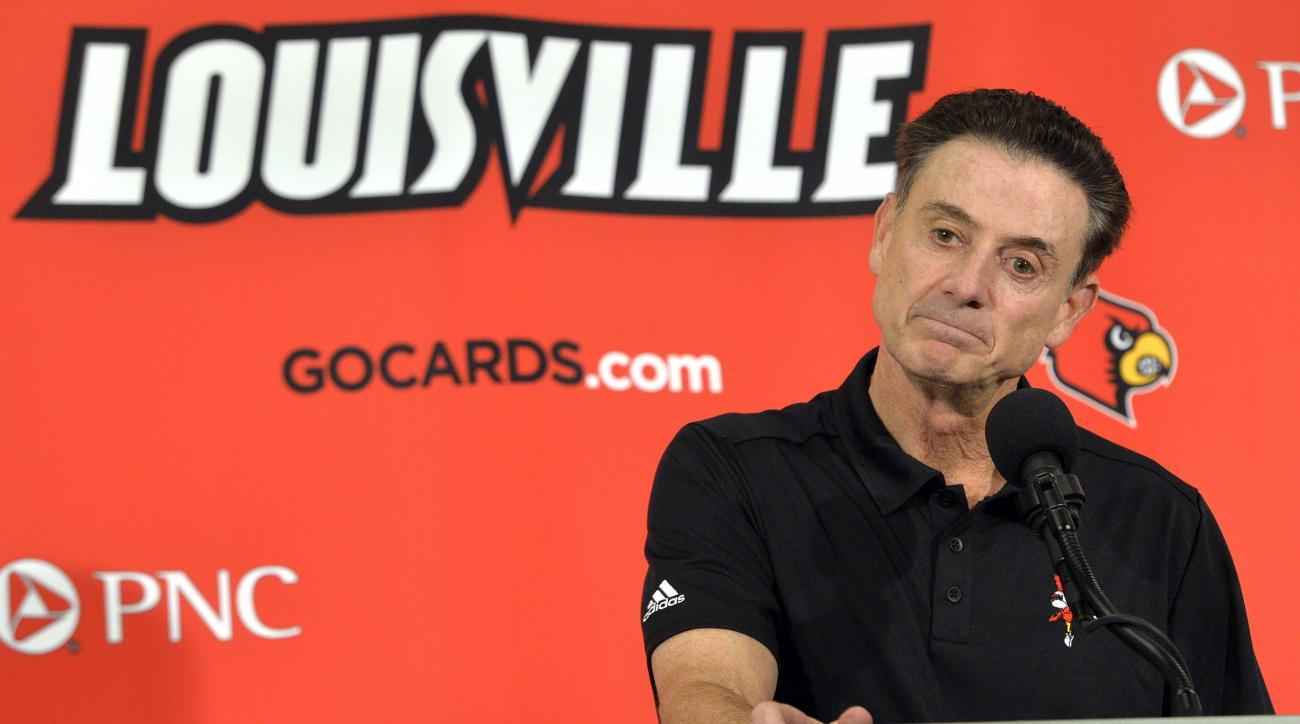 Louisville head coach Rick Pitino responds to a question following an NCAA college basketball team's intrasquad scrimmage Saturday, Oct. 3, 2015, in Louisville, Ky. (AP Photo/Timothy D. Easley)