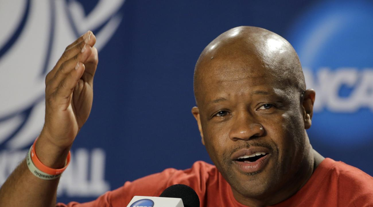 FILE - In this March 20, 2015 file photo, Arkansas head coach Mike Anderson gestures during a news conference at the NCAA college basketball tournament in Jacksonville, Fla. Arkansas enjoyed a fairy tale season a year ago, finishing with 27 wins and reach