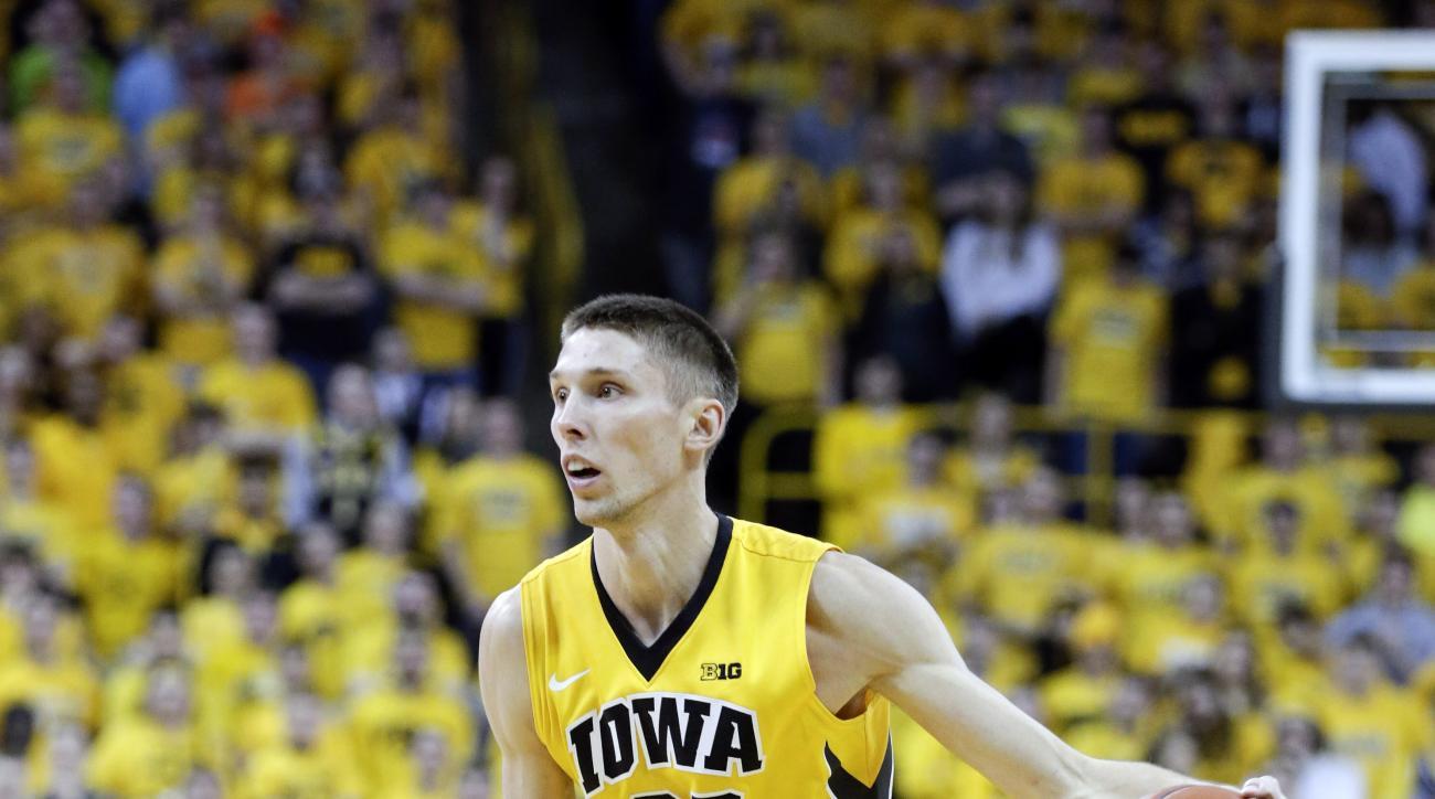 Iowa's Jarrod Uthoff (20) drives up court during the second half of an NCAA college basketball game against Wisconsin Saturday, Jan. 31, 2015, in Iowa City, Iowa. (AP Photo/Jim Slosiarek)