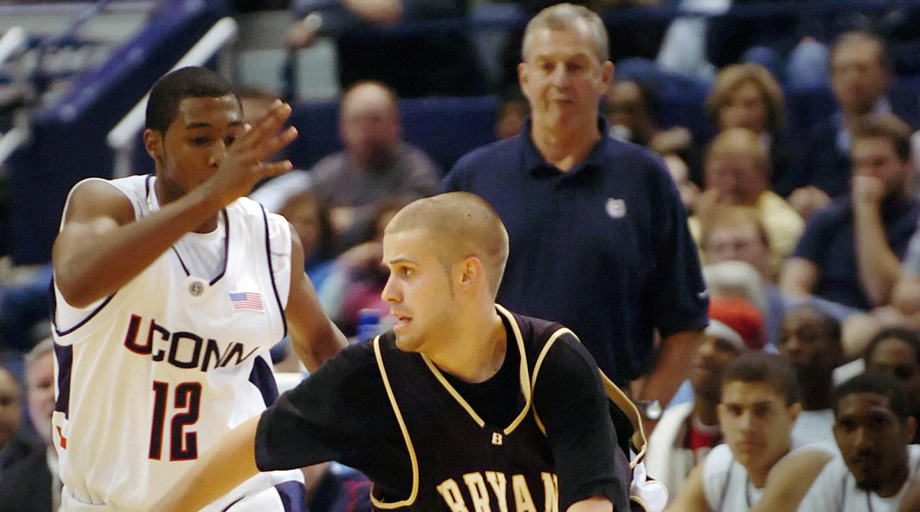 FILE - In this Nov. 6, 2006, file photo, Bryant's Chris Burns (14) drives against Connecticut's A.J. Price (12) during the second half of an exhibition basketball game at the Hartford Civic Center in Hartford, Conn. Division I men's basketball has its fir