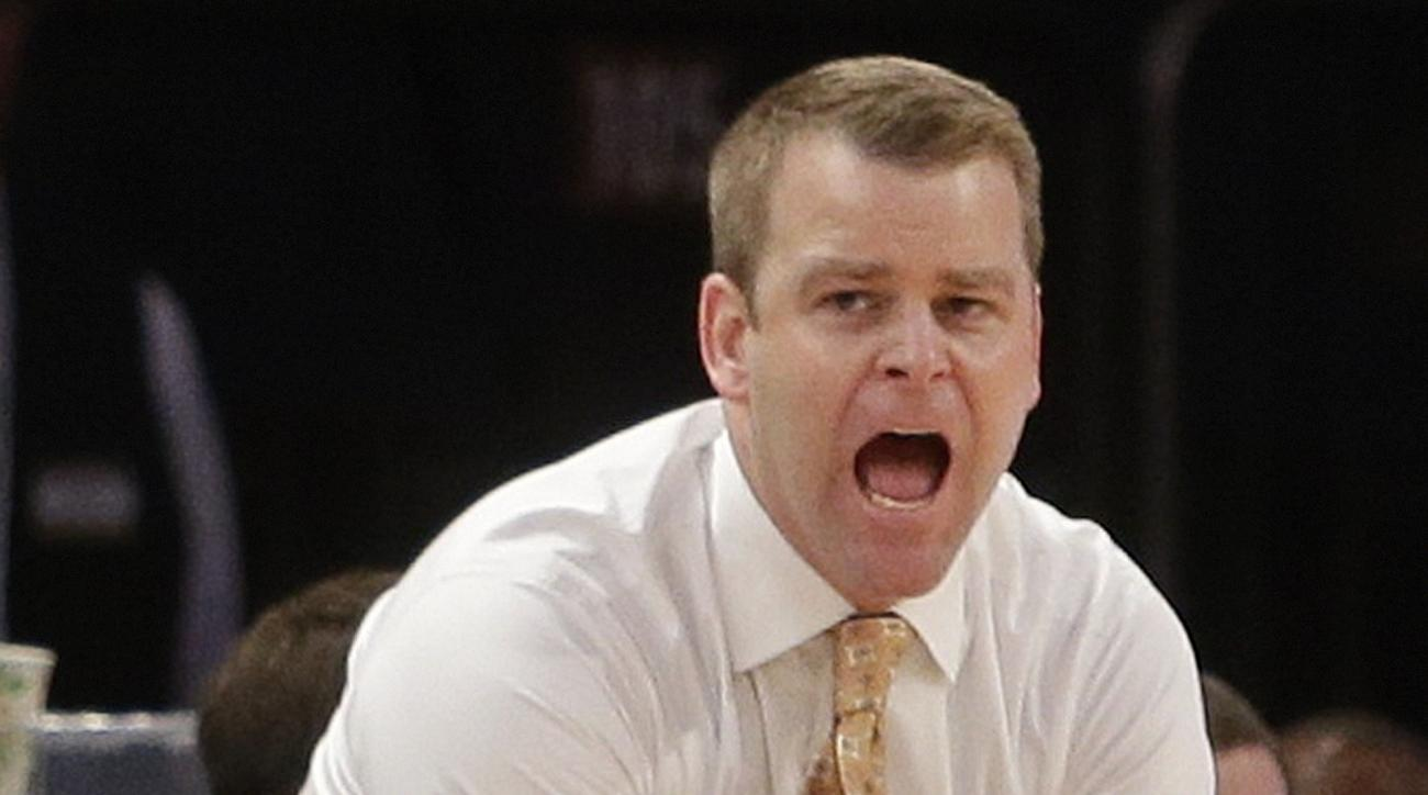 FILE - In this Jan. 21, 2015, file photo, Marquette head coach Steve Wojciechowski calls to his team during the first half of an NCAA college basketball game against St. John's in New York. There are so many fresh faces at Marquette that it might seem lik