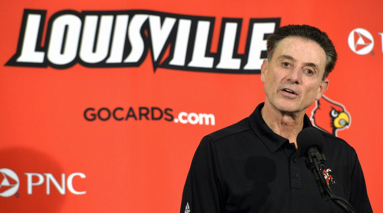 FILE - In this Saturday, Oct. 3, 2015 file photo, Louisville head coach Rick Pitino responds to a question following an NCAA college basketball team's intrasquad scrimmage in Louisville, Ky. Pitino, is among four Hall of Fame coaches leading programs deal