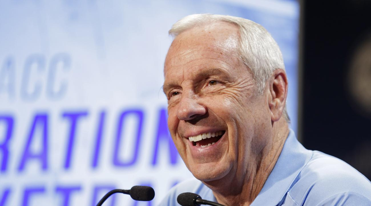 North Carolina NCAA college basketball coach Roy Williams answers a question during the Atlantic Coast Conference men's media day in Charlotte, N.C., Wednesday, Oct. 28, 2015. (AP Photo/Chuck Burton)