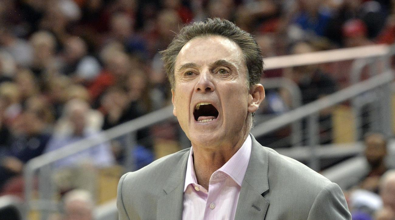 Louisville head coach Rick Pitino shouts instructions to his players during an NCAA college basketball game against Bellarmine, Sunday, Nov. 1, 2015, in Louisville, Ky. (AP Photo/Timothy D. Easley)