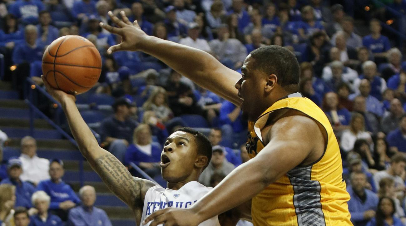Kentucky's Tyler Ulis, left, shoots as Ottawa's John O'con defends during an NCAA college basketball exhibition game Monday, Nov. 2, 2015, in Lexington, Ky. (AP Photo/James Crisp)