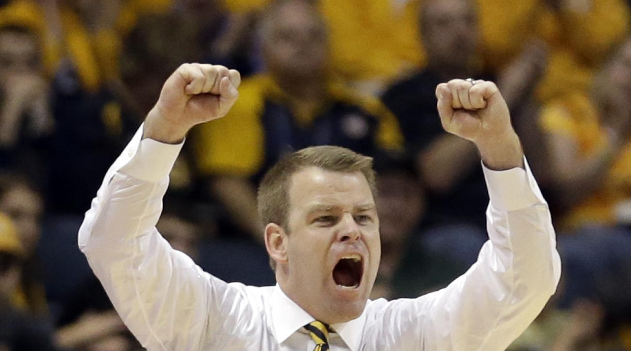 FILE - In this Dec. 28, 2014, file photo, Marquette head coach Steve Wojciechowski shouts during the second half of an NCAA college basketball game against Morgan State, in Milwaukee. Coach Steve Wojciechowski looks around the practice court at Marquette