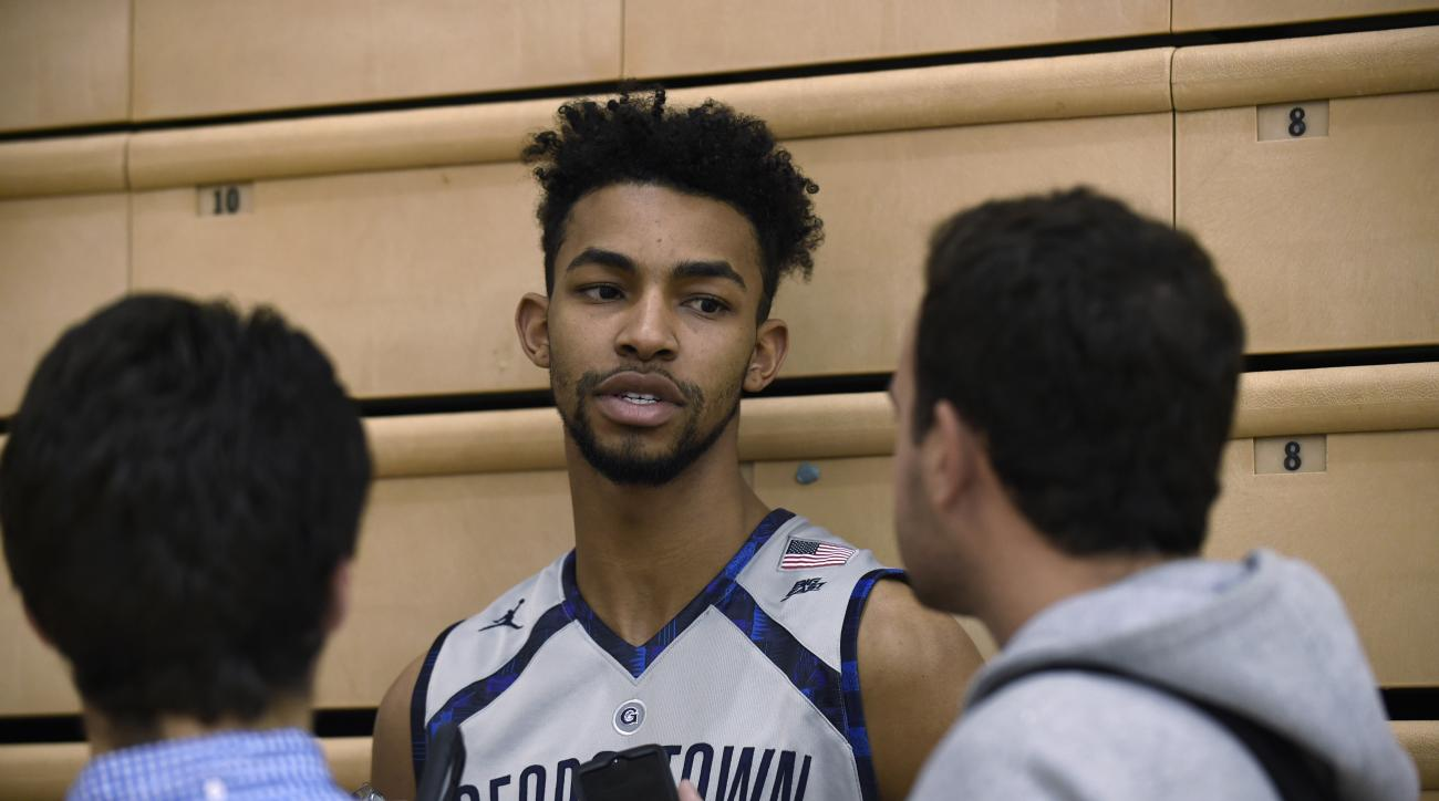 In this photo taken Oct. 27, 2015, Georgetown University men's basketball player Isaac Copeland speaks with reporters at McDonough Arena in Washington. Once again, Georgetown's season ended early, during the NCAA Tournament's opening week and, once again,