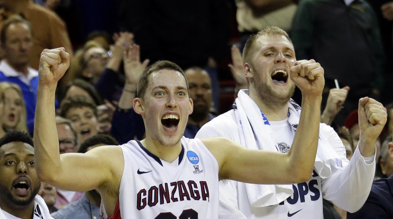 FILE - In this March 22, 2015, file photo, Gonzaga's Kyle Wiltjer (33) and Przemek Karnowski, right, celebrate in the final seconds of the second half of an NCAA tournament college basketball game against Iowa in the Round of 32, in Seattle. No. 9 Gonzaga