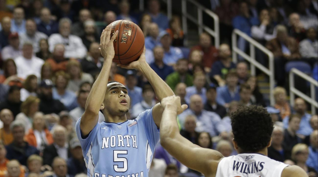FILE - In this March 13, 2015, file photo, North Carolina's Marcus Paige (5) shoots over Virginia's Isaiah Wilkins (21) during the second half of an NCAA college basketball game in the semifinals of the Atlantic Coast Conference tournament in Greensboro,