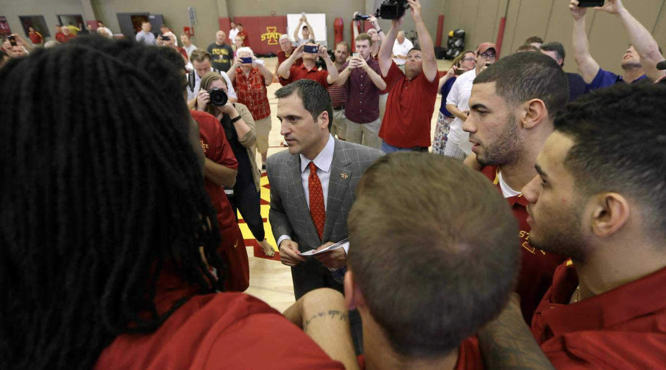 In this June 9, 2015, photo, new Iowa State men's basketball coach Steve Prohm, center, talks with senior Georges Niang, second from right, and his teammates following a news conference in Ames, Iowa. Prohm has inherited one of the nation's most talented
