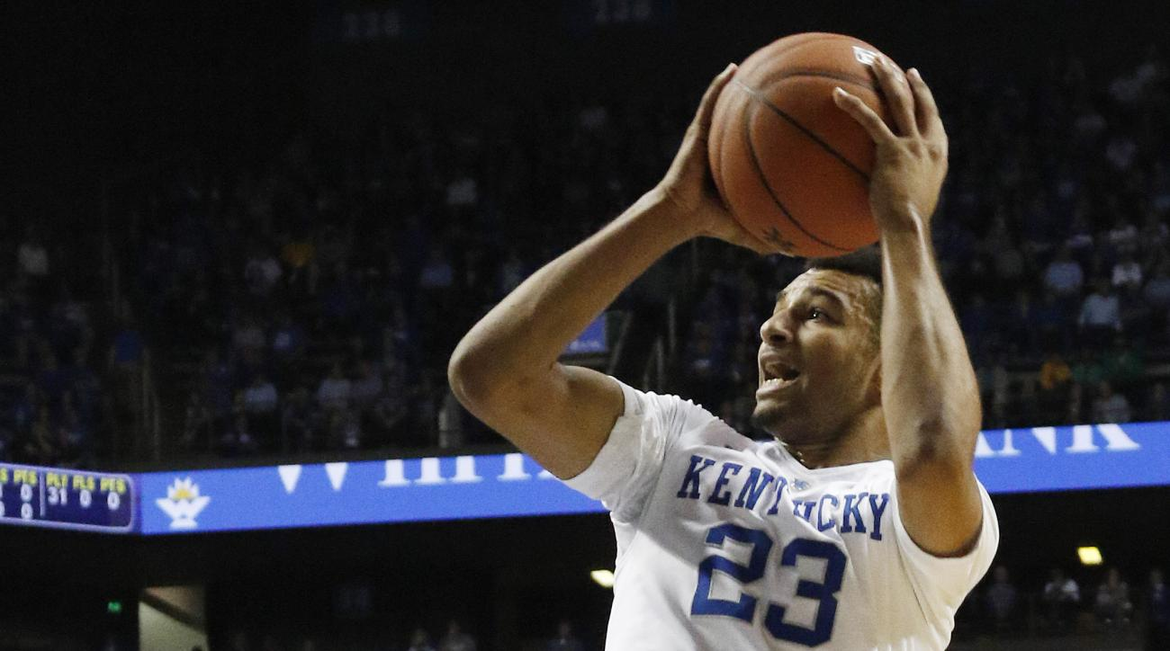 Kentucky's Jamal Murray (23) shoots over the defense of Kentucky State's Michael Cross (31) during an NCAA college basketball exhibition game Friday, Nov. 6, 2015, in Lexington, Ky. (AP Photo/James Crisp)