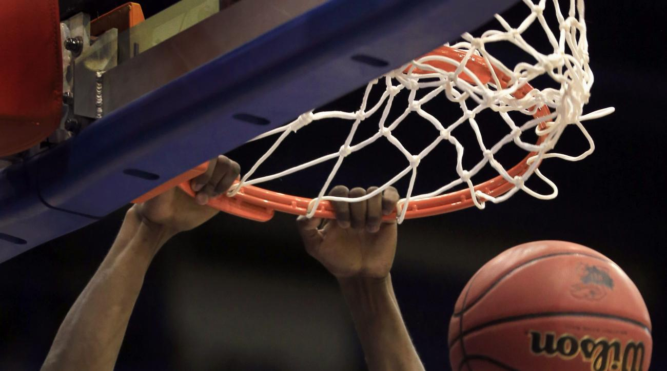 Kansas guard Lagerald Vick dunks during the first half of an exhibition NCAA college basketball exhibition game against the Fort Hays State in Lawrence, Kan., Tuesday, Nov. 10, 2015. (AP Photo/Orlin Wagner)