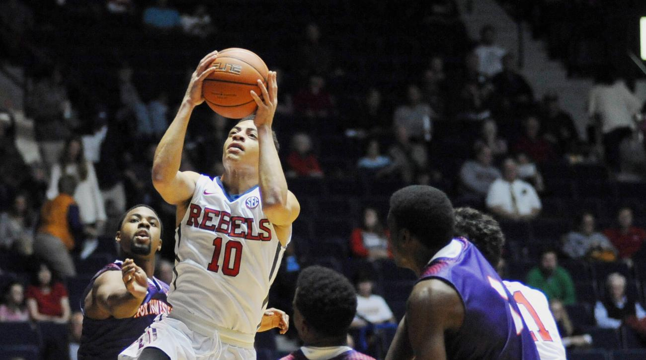 Mississippi's Sam Finley (10) scores as Northwestern State's Sabri Thompson, left, defends during an NCAA college basketball game in Oxford, Miss., Friday, Nov. 13, 2015. (Bruce Newman/The Oxford Eagle via AP)  NO SALES; MANDATORY CREDIT