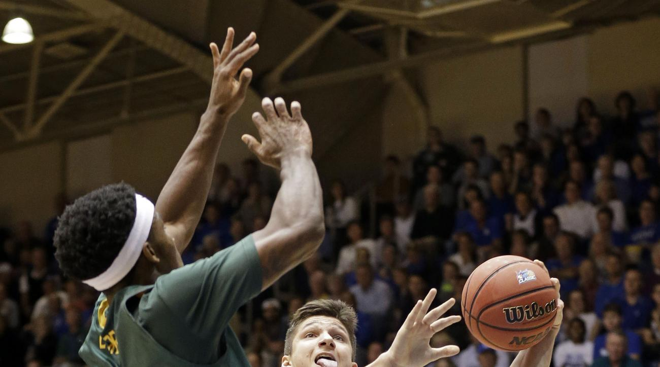 Duke's Grayson Allen (3) drives to the basket as Siena's Nico Clareth (15) defends during the first half of an NCAA college basketball game in Durham, N.C., Friday, Nov. 13, 2015. (AP Photo/Gerry Broome)