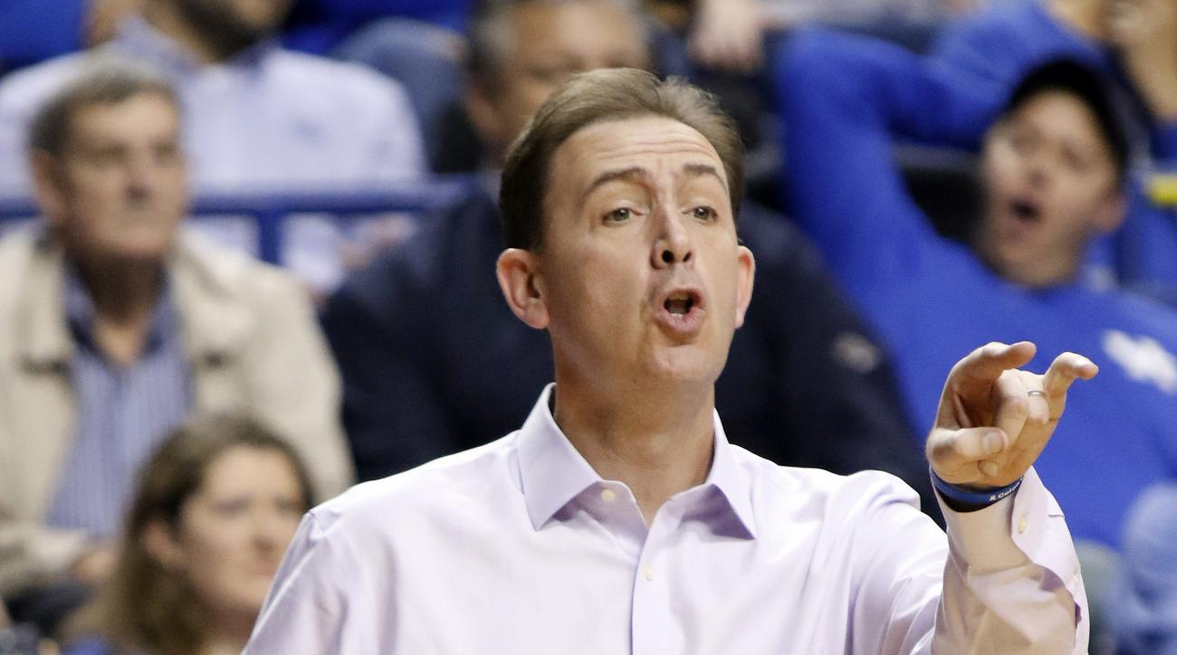 Albany head coach Will Brown shoots instructions during an NCAA college basketball game against Kentucky, Friday, Nov. 13, 2015, in Lexington, Ky. (AP Photo/James Crisp)