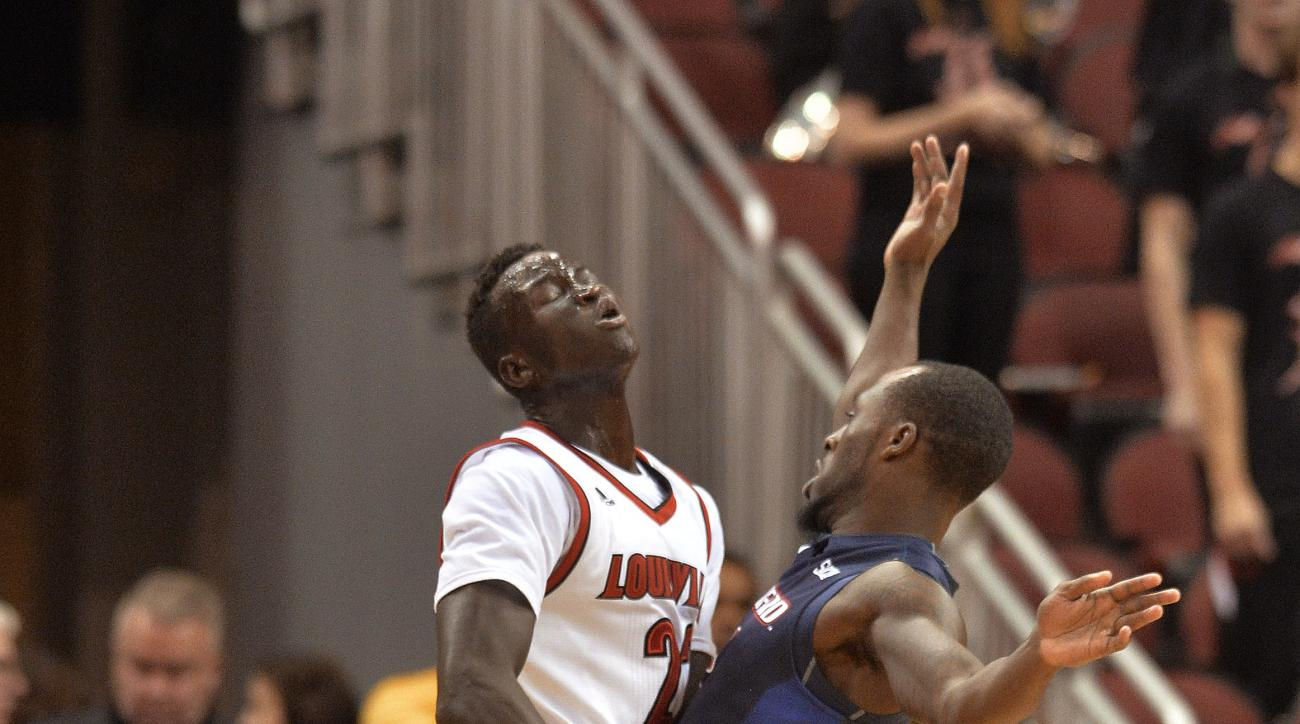 Samford's Marcus Johnson (2) runs into Louisville's Deng Adel (22) during the first half of an NCAA college basketball game Friday, Nov. 13, 2015, in Louisville, Ky. (AP Photo/Timothy D. Easley)