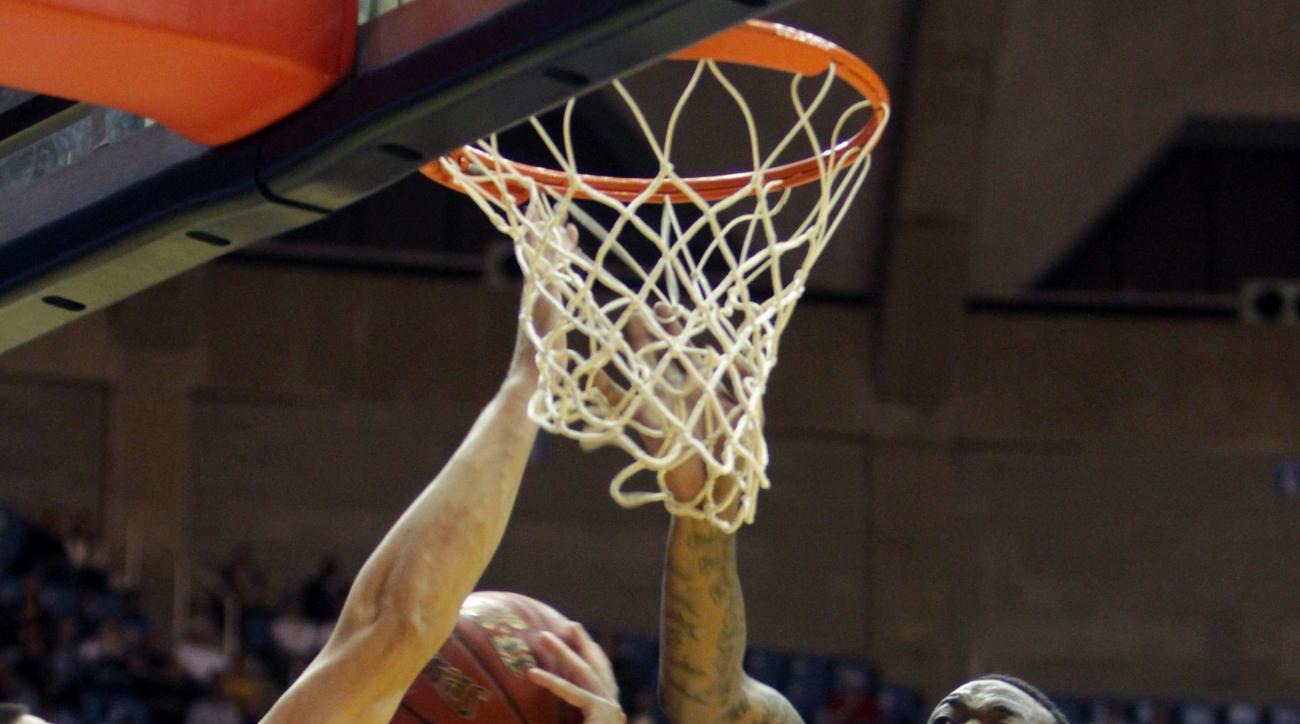 West Virginia forward Elijah Macon (45) blocks Northern Kentucky center Drew McDonald (34) shot during the first half of an NCAA college basketball game, Friday, Nov, 13, 2015, in Morgantown, W.Va. (AP Photo/Raymond Thompson)