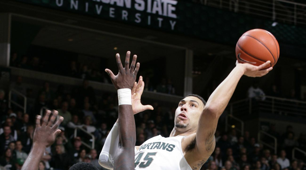 Michigan State's Denzel Valentine, right, shoots against Florida Atlantic's C.J. Turman (0) during the first half of an NCAA college basketball game, Friday, Nov. 13, 2015, in East Lansing, Mich. (AP Photo/Al Goldis)