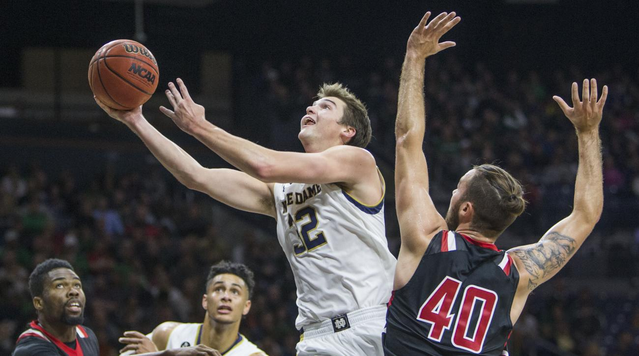 Notre Dame's Steve Vasturia (32) goes up for a shot next to St. Francis (Pa.)'s RonnieDrinnon (40) during the first half of an NCAA college basketball game Friday, Nov. 13, 2015, in South Bend, Ind.  (AP Photo/Robert Franklin)