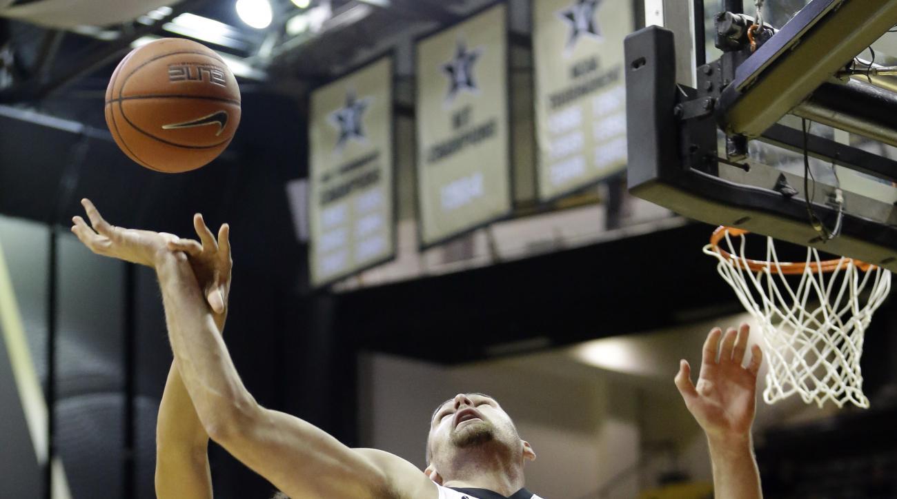 Vanderbilt forward Samir Sehic (21) and Austin Peay guard Jared Savage (2) reach for a rebound in the first half of an NCAA college basketball game Friday, Nov. 13, 2015, in Nashville, Tenn. (AP Photo/Mark Humphrey)