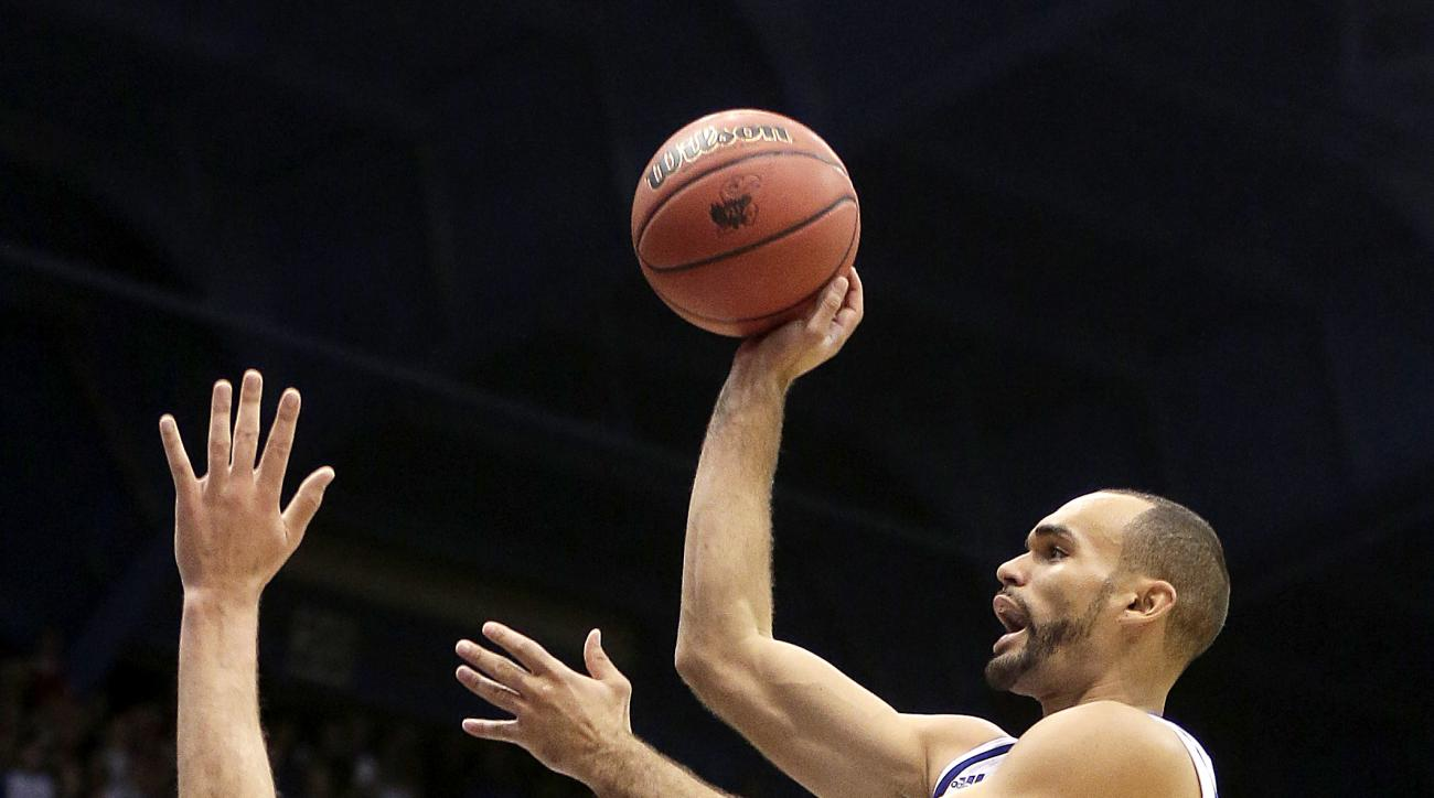 Kansas' Perry Ellis gets past Northern Colorado's Tanner Morgan (20) to put up a shot during the first half of an NCAA college basketball game Friday, Nov. 13, 2015, in Lawrence, Kan. (AP Photo/Charlie Riedel)